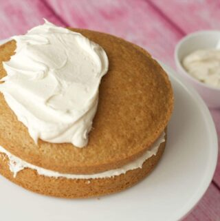 Vegan vanilla frosting on top of a vanilla cake