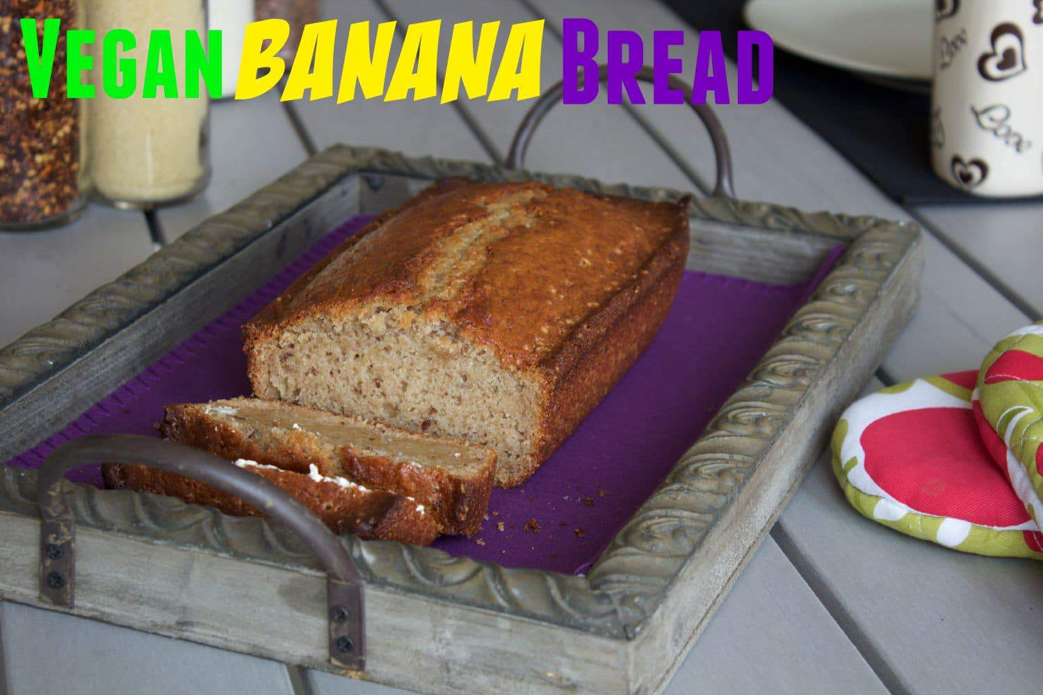 Simple Vegan Banana Bread - crispy on the outside, moist on the inside and delicious served warm from the oven and spread with vegan butter! #vegan #dairy-free #lovingitvegan