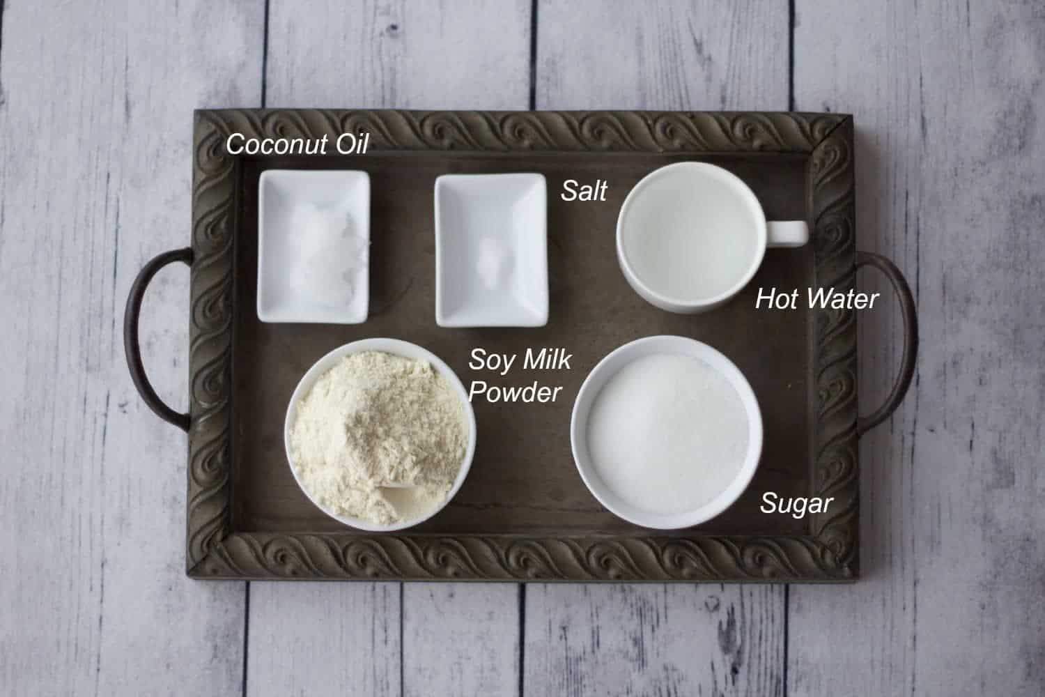 Ingredients for vegan condensed milk on a tray.