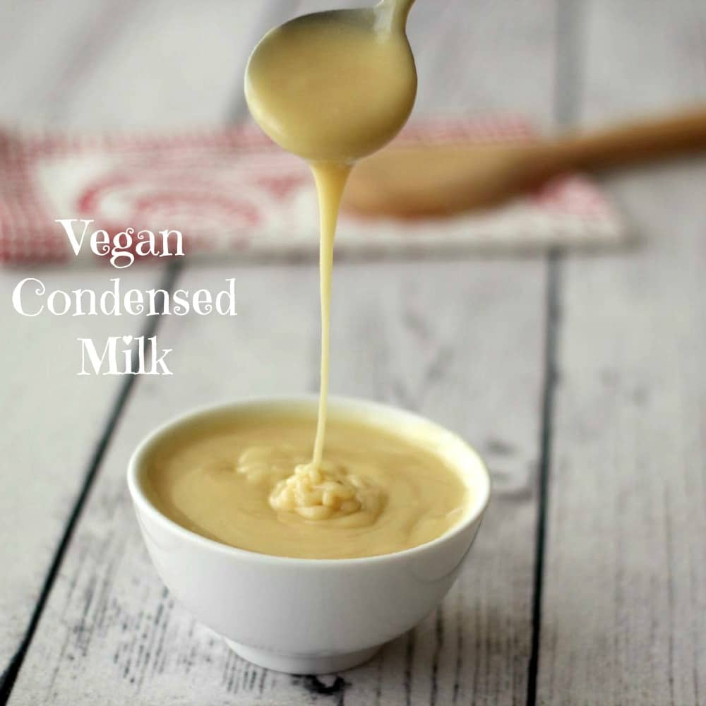 Vegan condensed milk in a white bowl with a spoon.