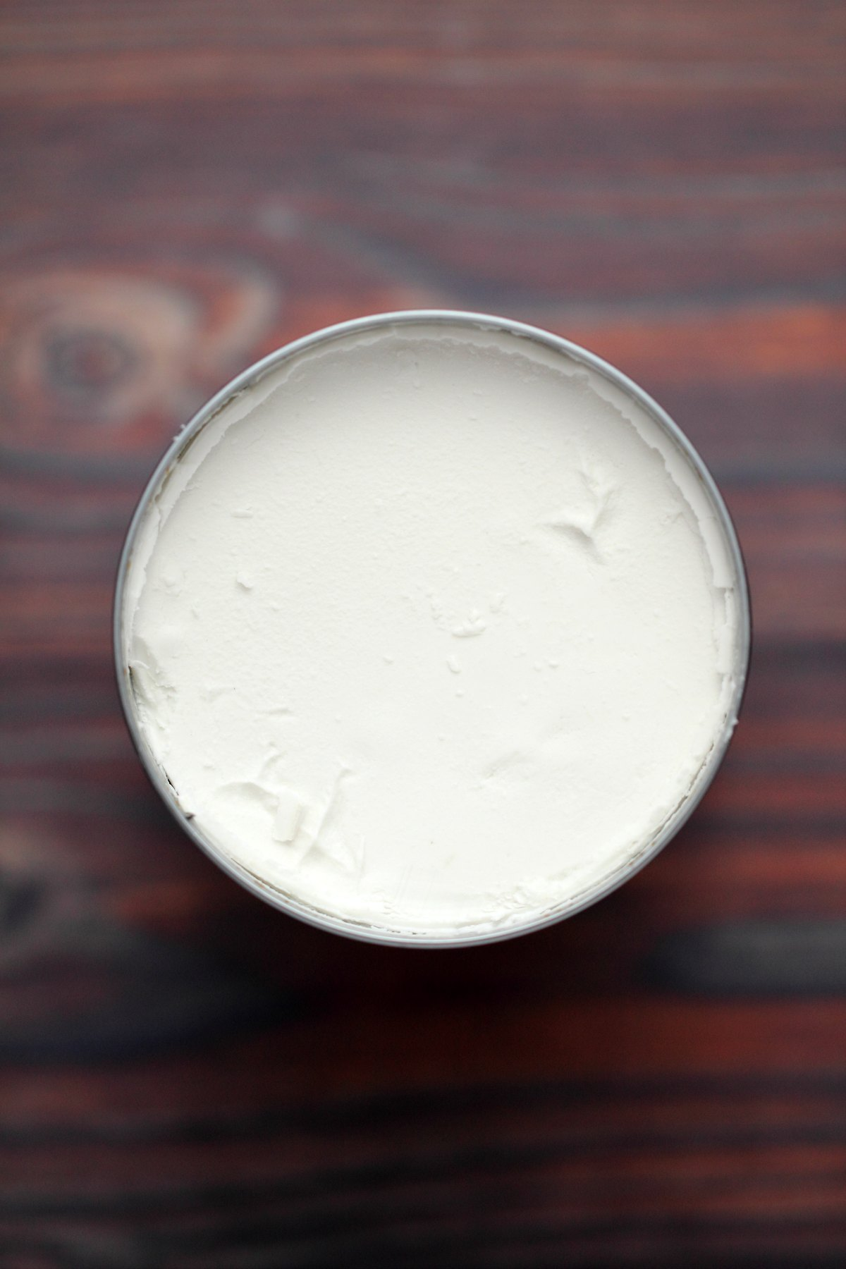 A chilled can of coconut cream, with hard cream at the top.