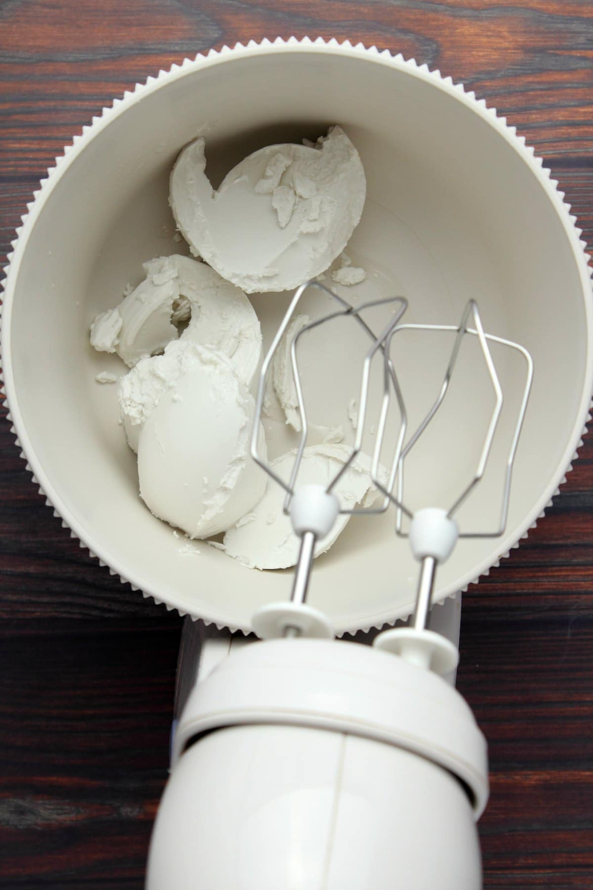 Hardened coconut cream in an electric mixer.