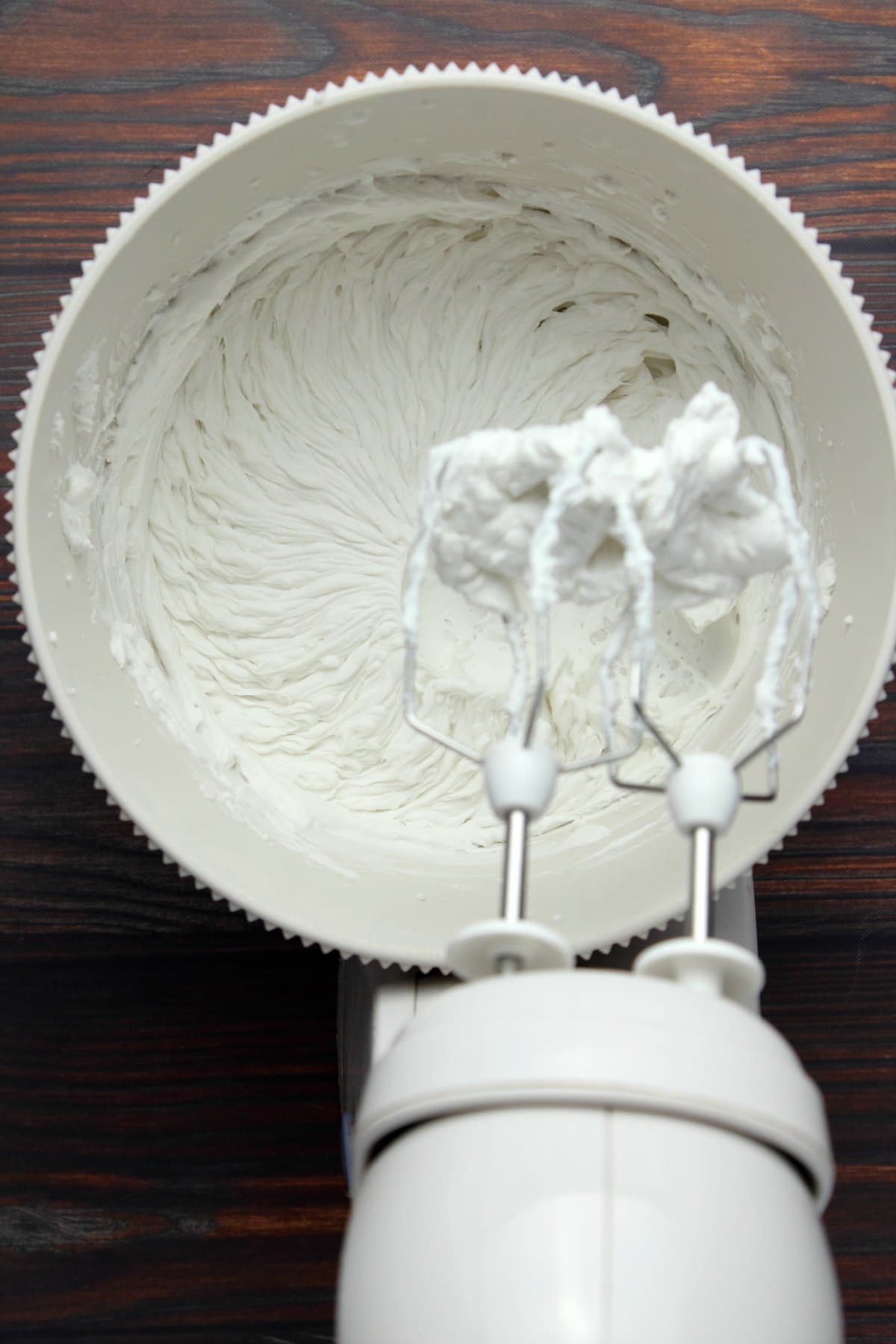 Vegan whipped cream in an electric mixer.