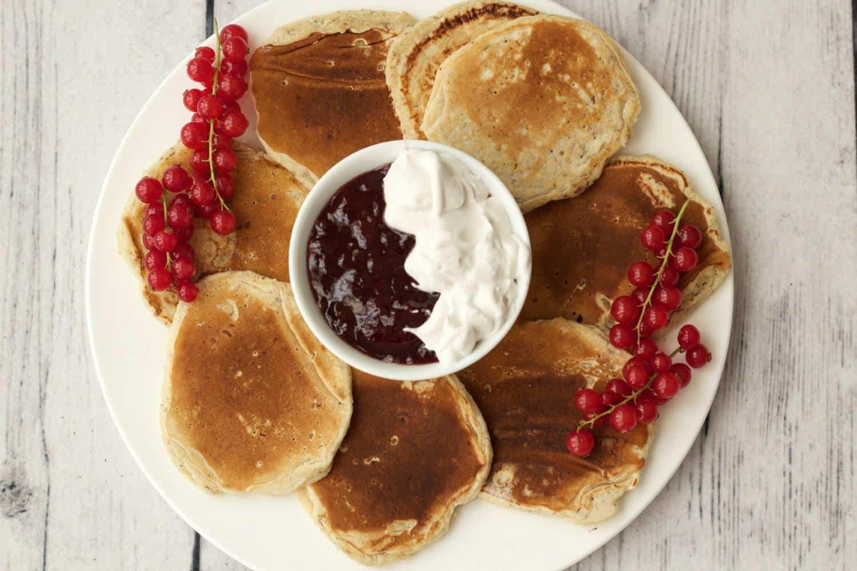 Vegan Pancakes served with jam and whipped coconut cream #vegan #lovingitvegan #dairy-free