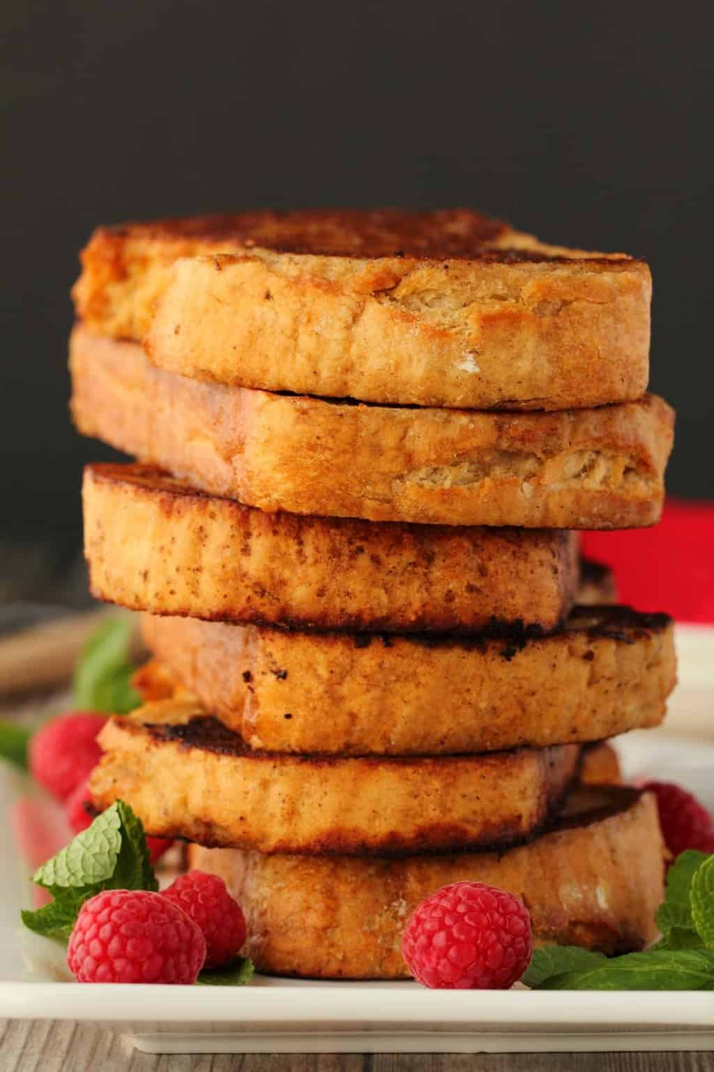 A stack of vegan french toast on a white plate.