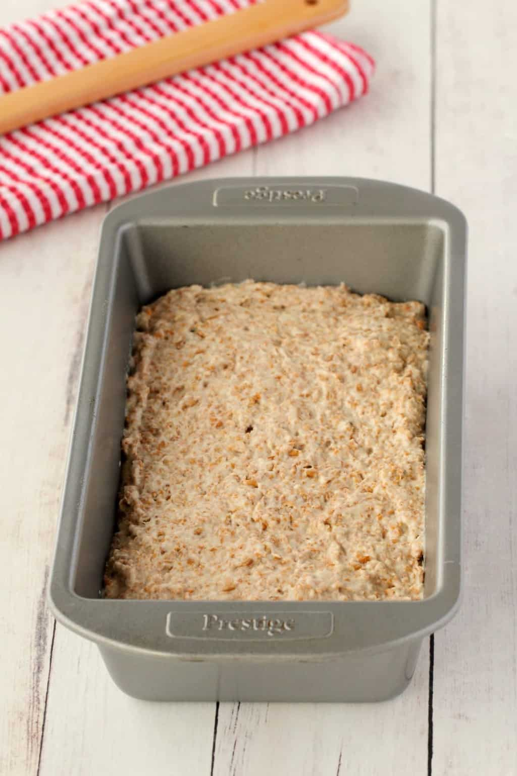 Wholewheat Bread dough in a loaf pan.