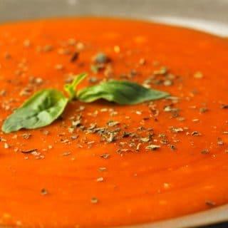 Vegan tomato soup in a ceramic bowl.