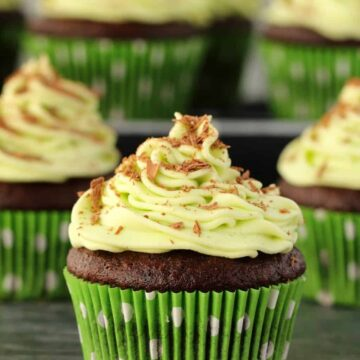 Vegan chocolate cupcakes topped with mint frosting.