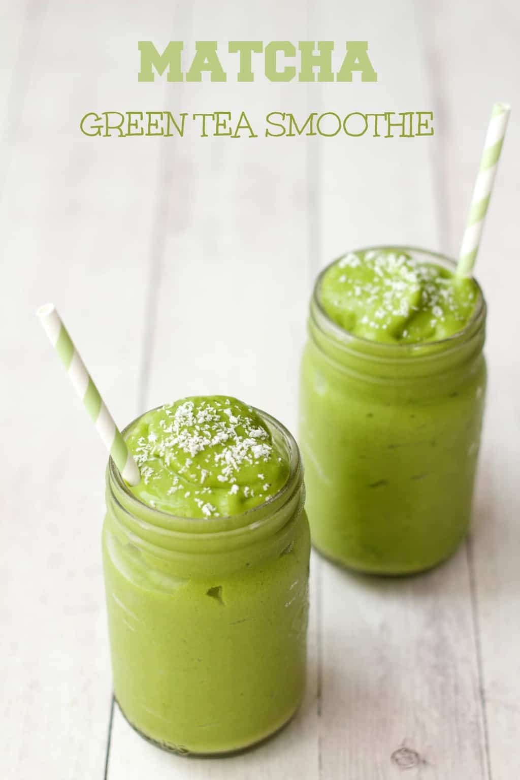 Matcha green tea smoothie topped with dessicated coconut in glasses with green and white striped straws.