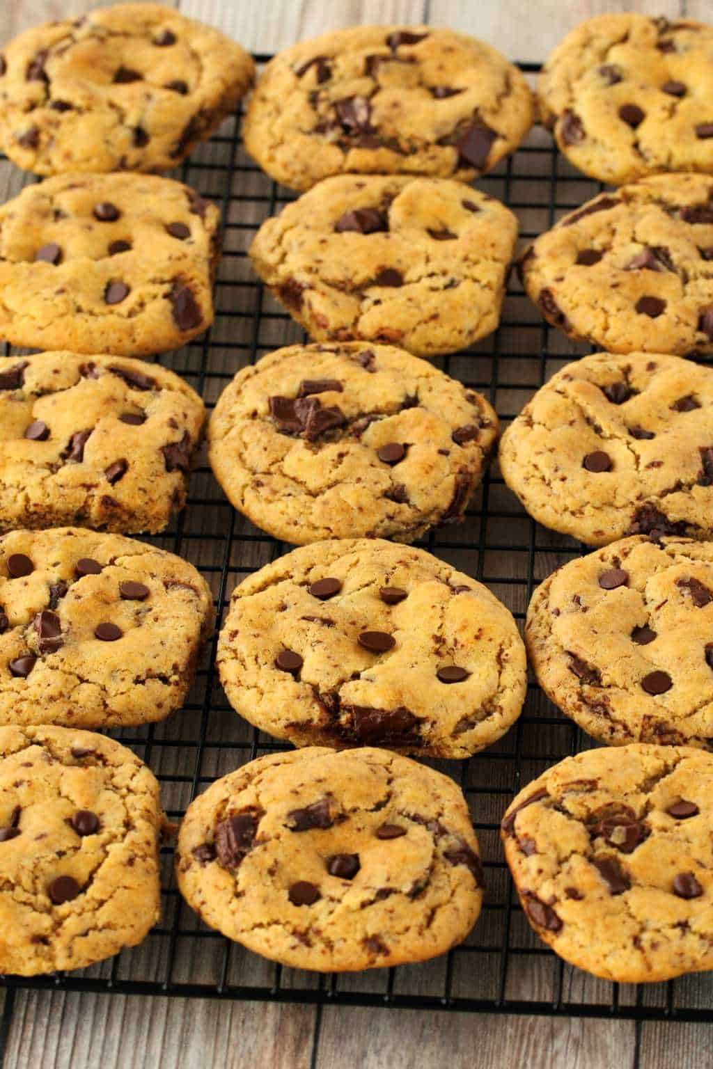 Vegan Chocolate Chip Cookies on a wire cooling rack.