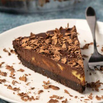 Vegan chocolate tart on a white plate.