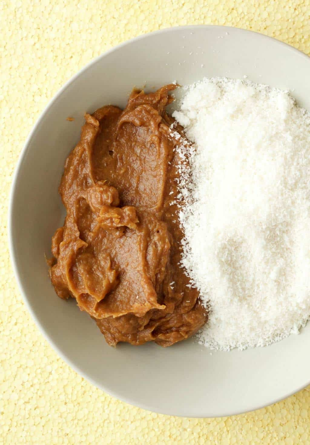 Making Chocolate Coconut Date Balls #vegan #lovingitvegan #dessert #dateballs