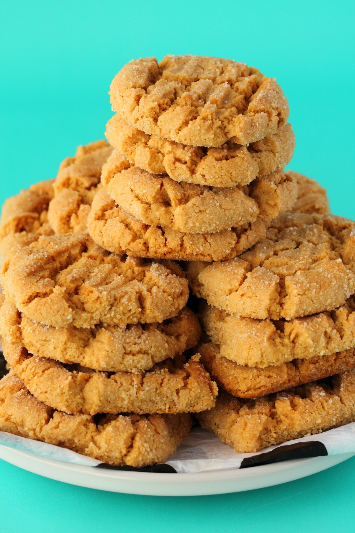 Cookies stacked up on a white plate.