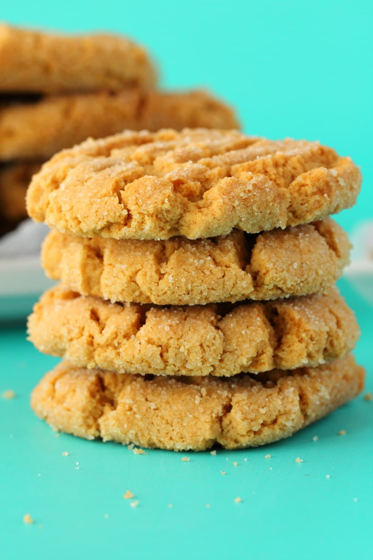 A stack of four peanut butter cookies.