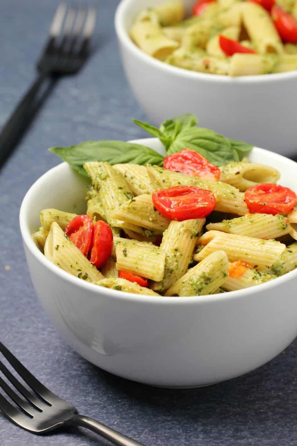 Vegan pesto pasta in a white bowl.