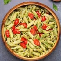Vegan pesto pasta in a wooden bowl.