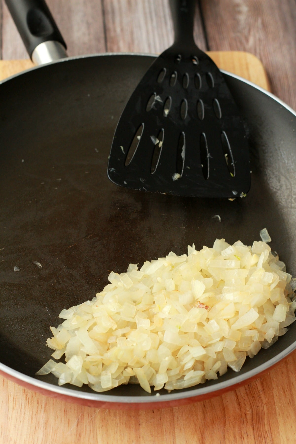 Onions and garlic frying in a pan.