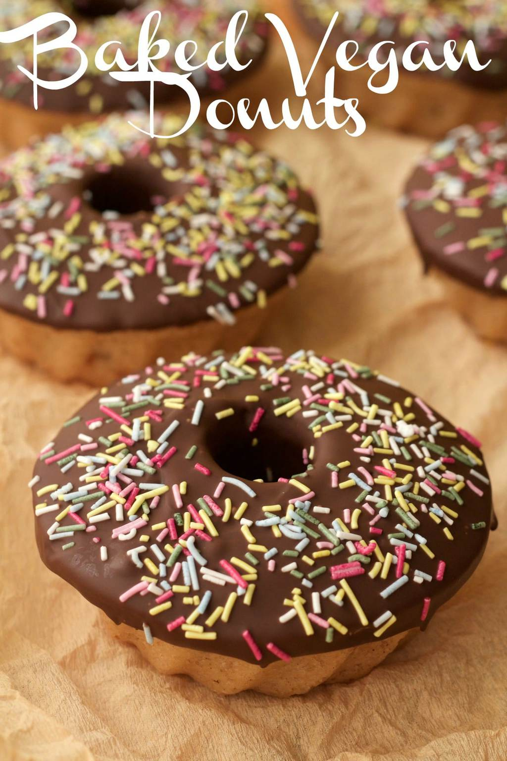 Vegan donuts topped with chocolate and sprinkles.