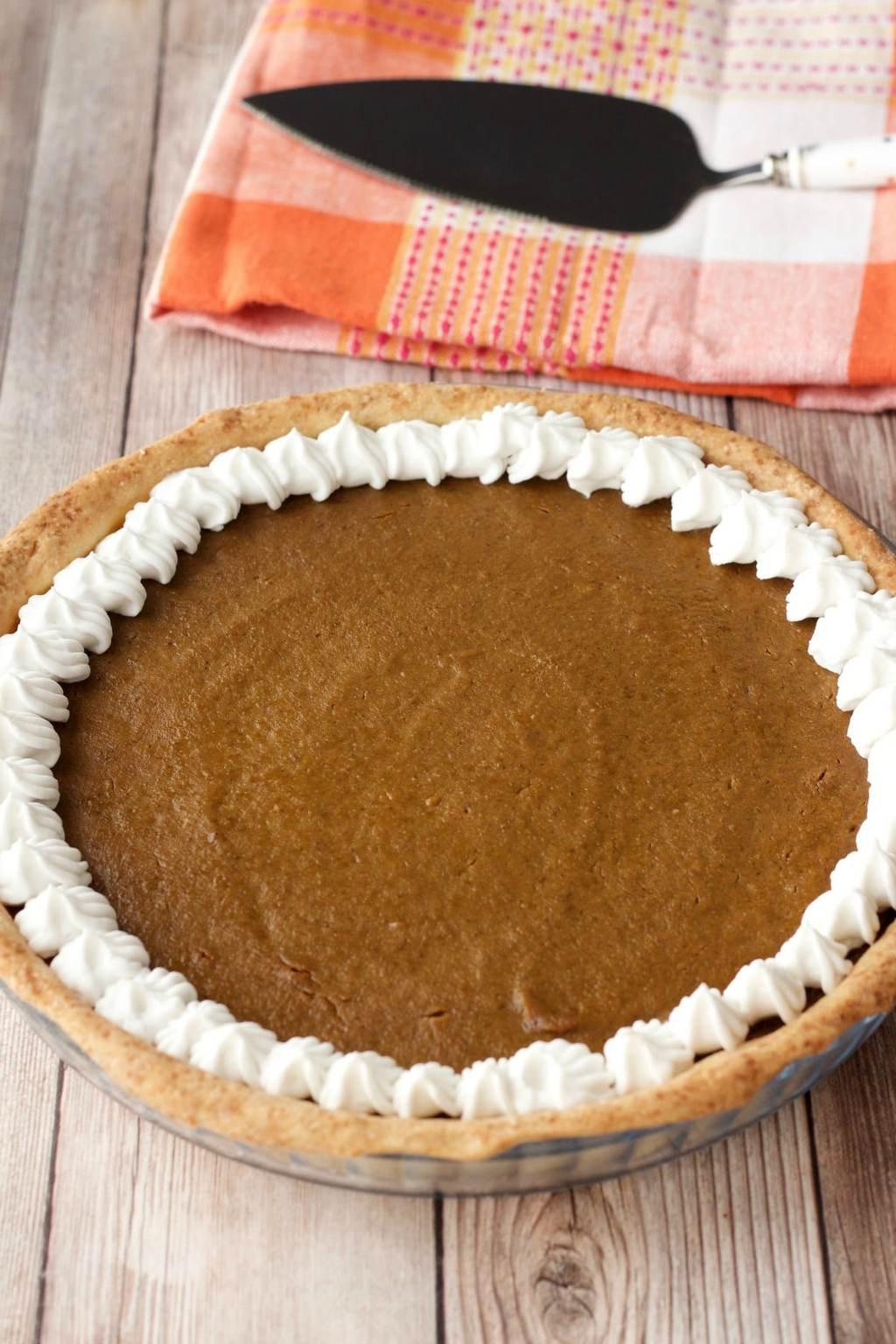 Freshly baked vegan pumpkin pie with whipped cream.