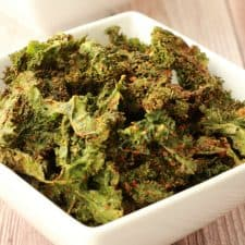 Kale chips in a white bowl.