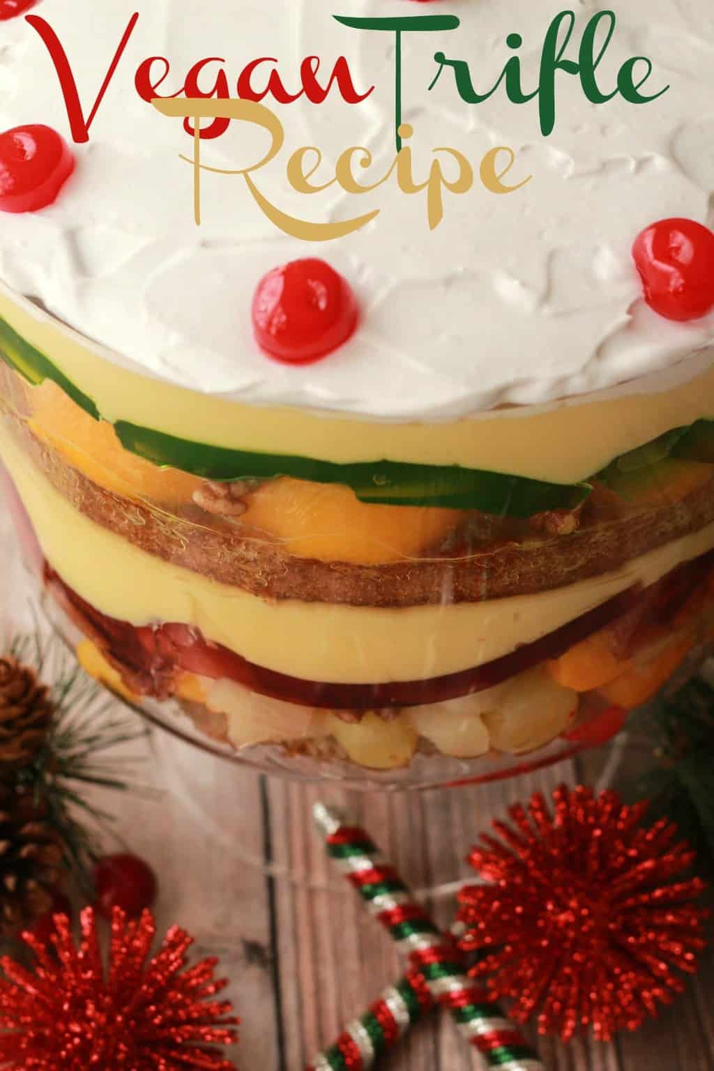 Festive and colorful vegan trifle recipe. Multi-layered trifle filled with fruits, nuts, custard, vegan jello and vanilla sponge cake soaked in sherry! #vegan #lovingitvegan #trifle #holidays #christmas #dessert