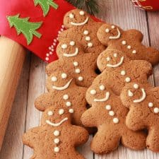Vegan gingerbread cookies lined up in the shape of a Christmas tree