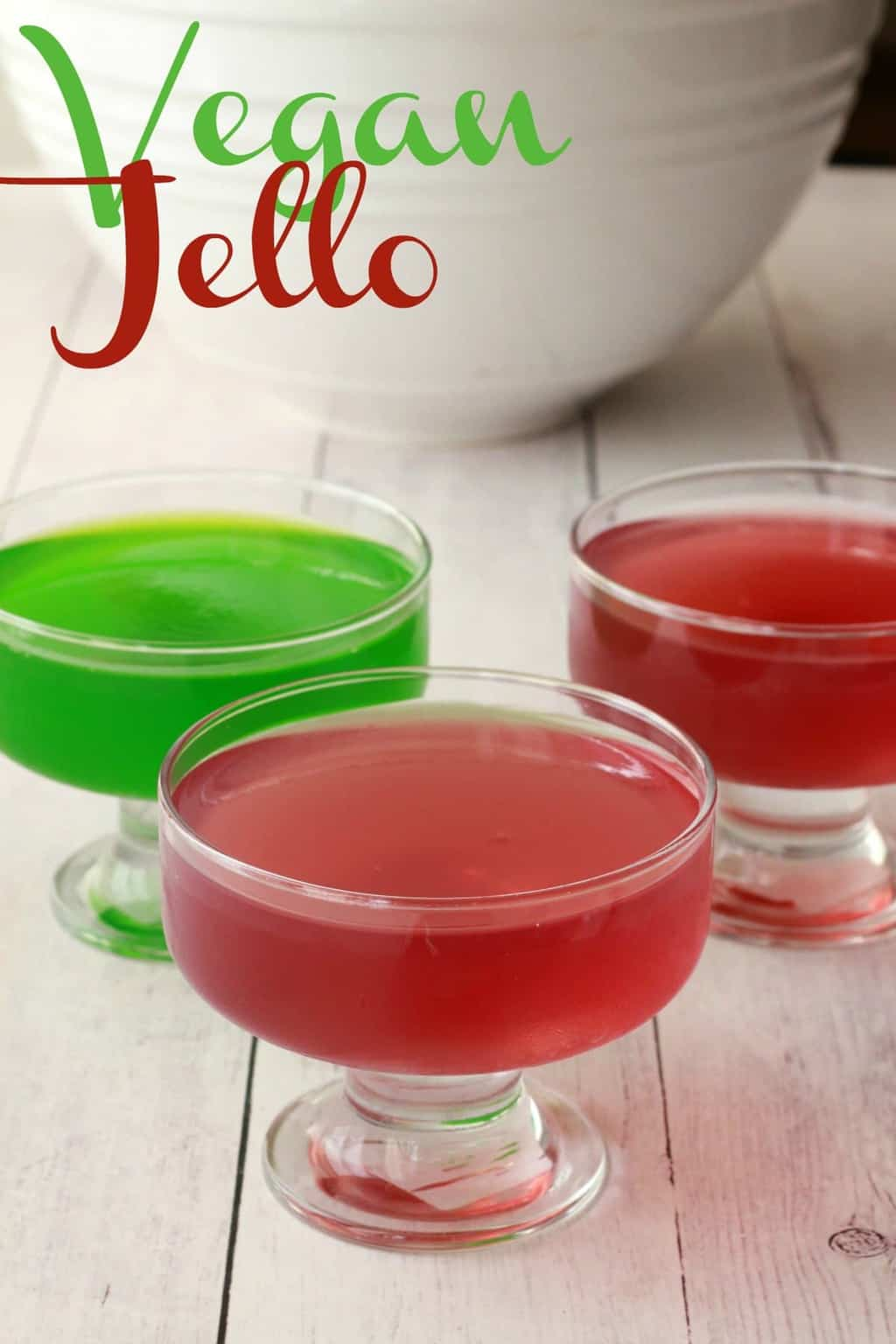 Vegan Jello in fun and fruity red and green colors in glass dishes.