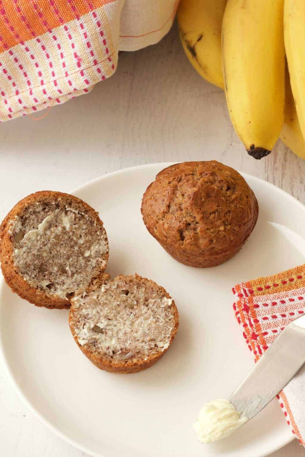 Easy Vegan Banana Bread Muffins. Delicious served warm or cold, with or without vegan butter! Moist, packed with banana flavor, and fabulous for breakfast! #vegan #lovingitvegan #bananabreadmuffins #muffins #breakfast
