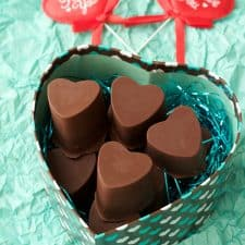 Vegan chocolate caramels in a heart shaped box.
