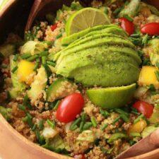 Vegan quinoa salad in a wooden serving bowl.
