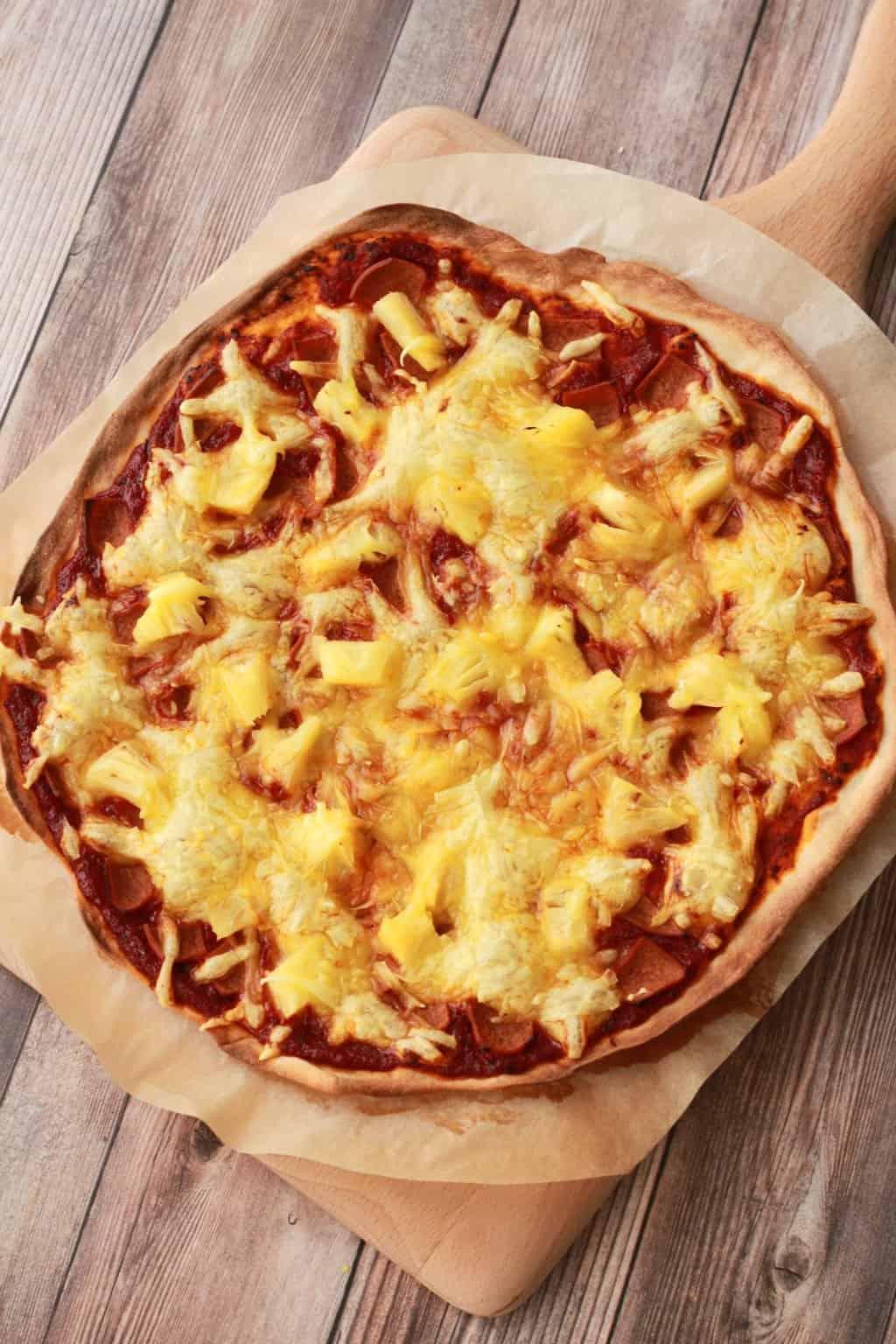 Thin-Crust Vegan Pizza. Made from scratch with homemade vegan pizza dough, a homemade tomato sauce and Hawaiian toppings! #vegan #lovingitvegan #veganpizza #pizza
