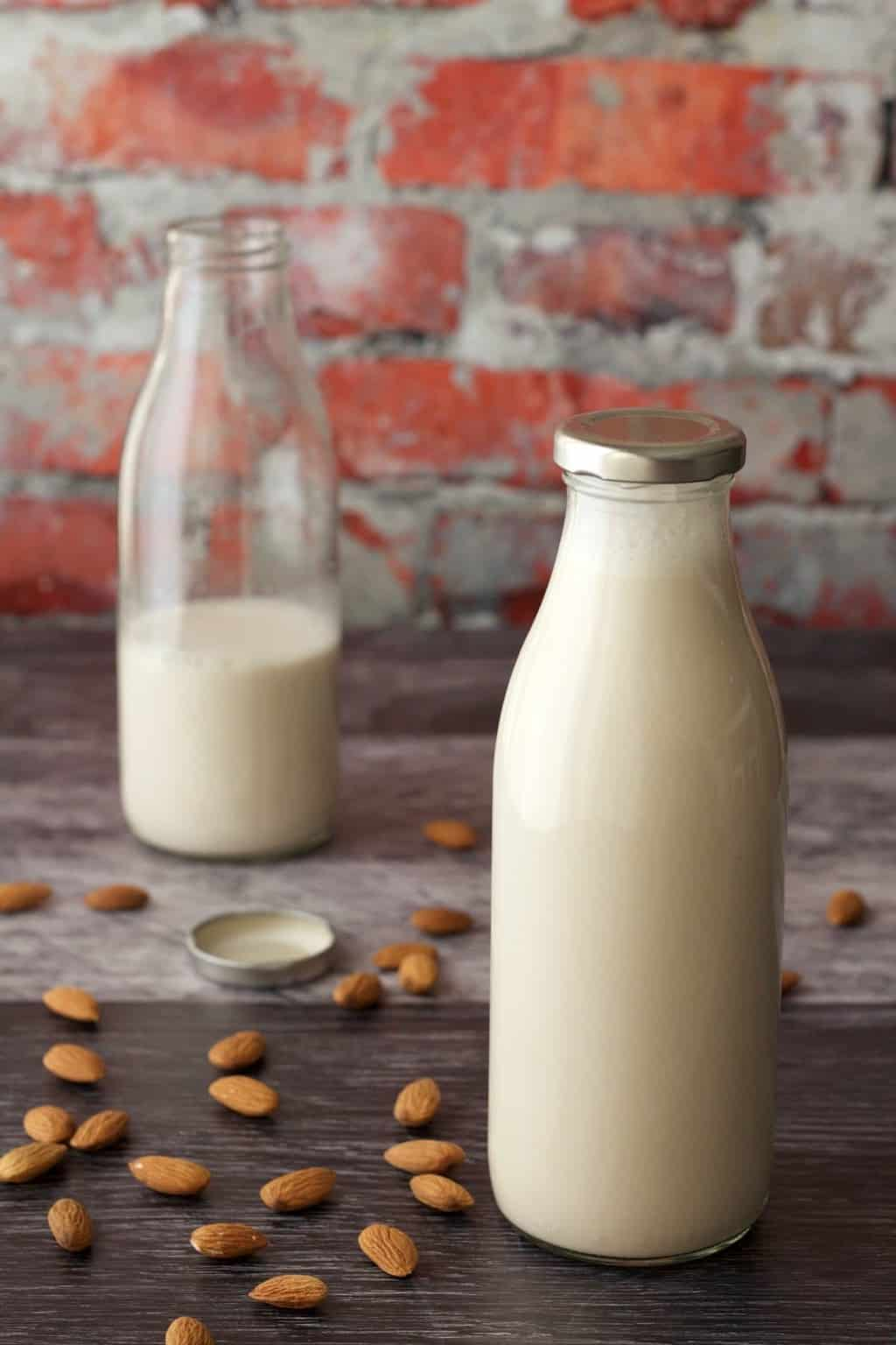 Homemade almond milk in glass milk bottles.