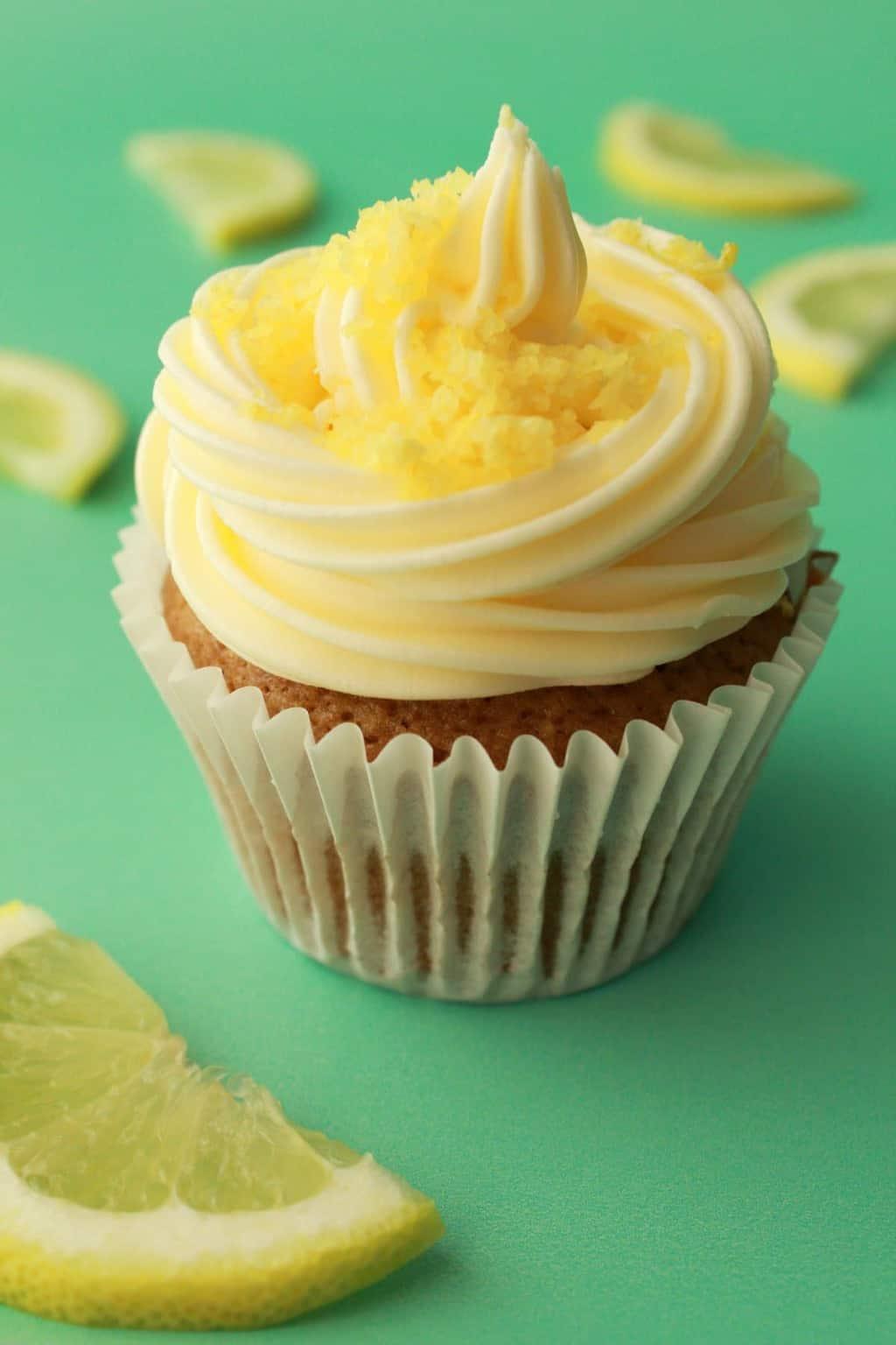 Vegan lemon cupcake topped with lemon frosting and lemon zest