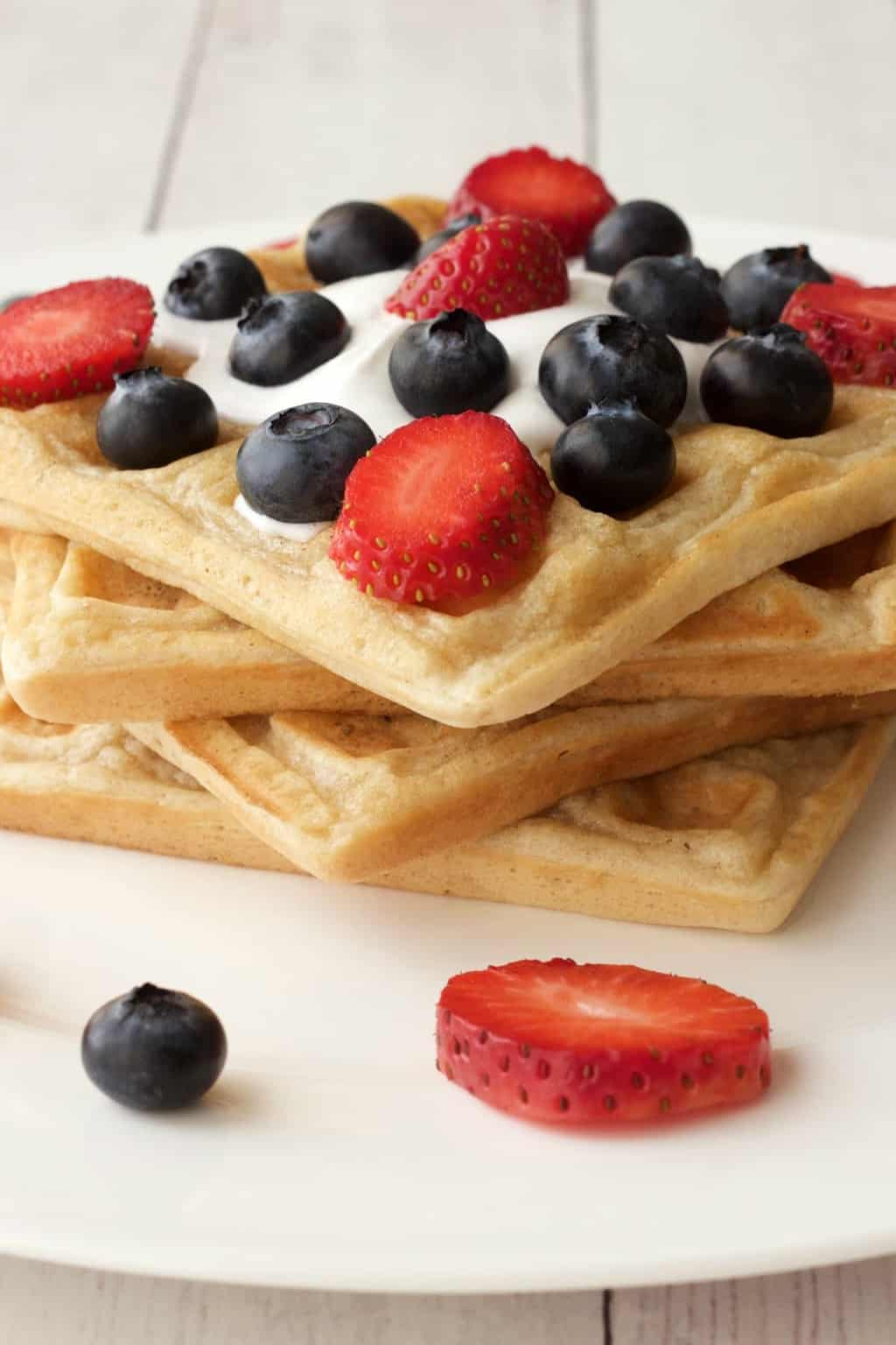 Classic Vegan Waffles Recipe. Perfect for breakfast served with vegan whipped cream, fresh fruit and syrup. #vegan #lovingitvegan #breakfast #waffles