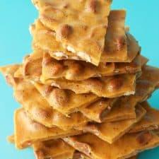 Vegan peanut brittle pieces in a stack.