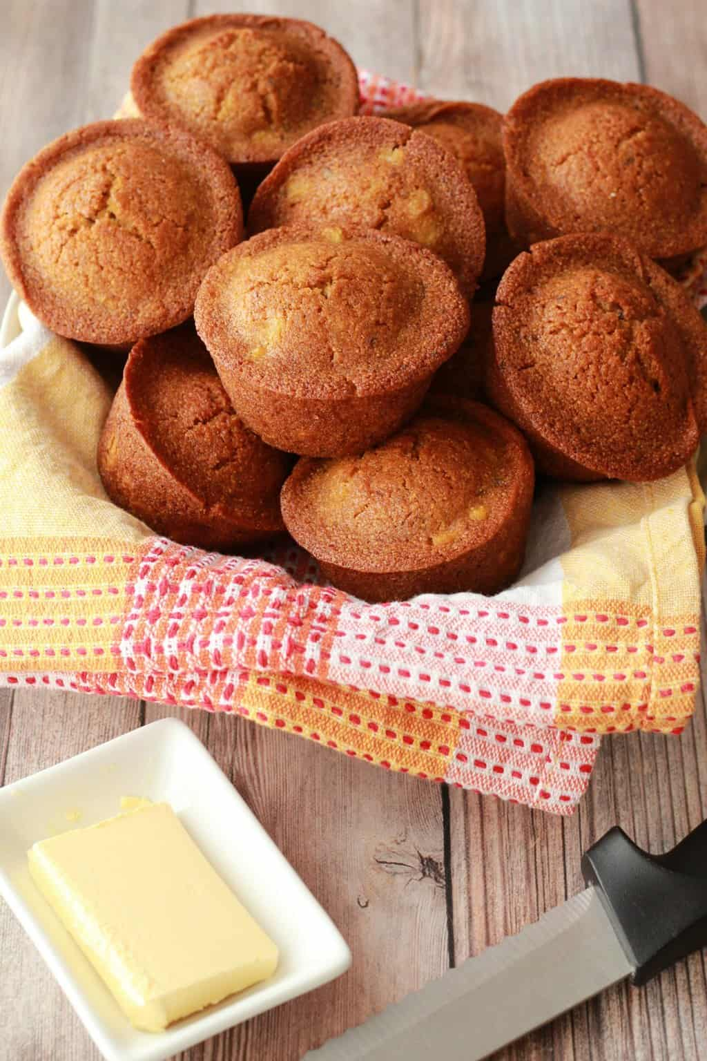 Cornbread muffins stacked up in a bowl.