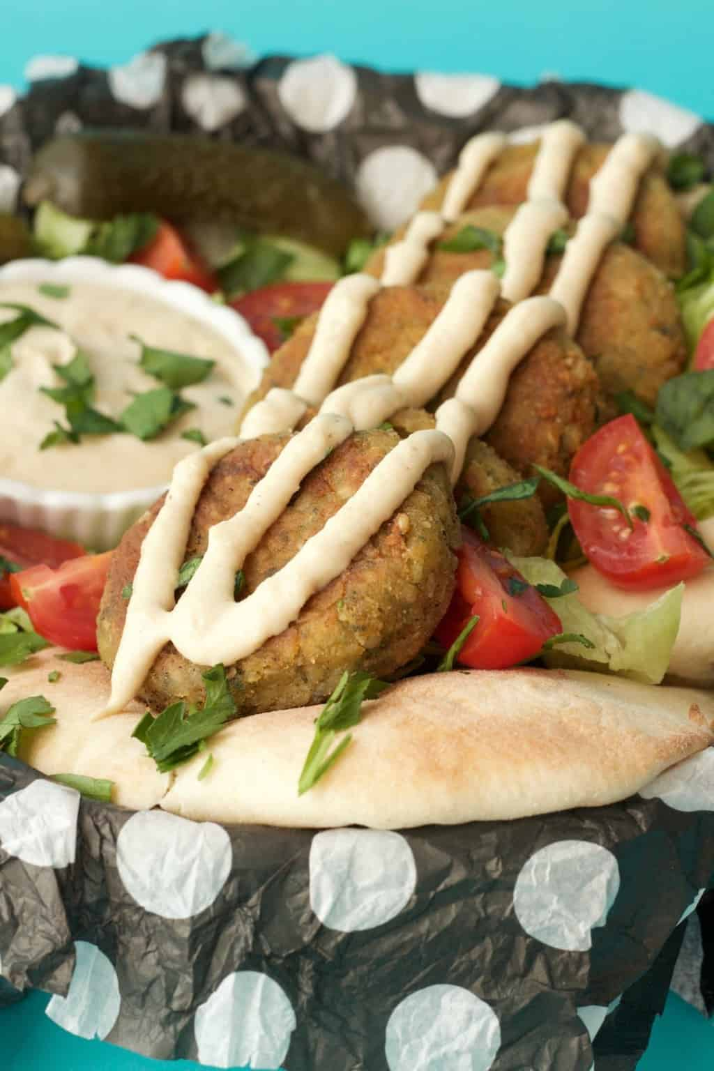 Easy Vegan Falafel Recipe with a Tahini Garlic Sauce! Crispy and perfectly browned. Delicious for a plant-based dinner! #vegan #lovingitvegan #veganfalafel #entree #dinner