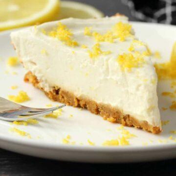 Slice of vegan lemon pie on a white plate.