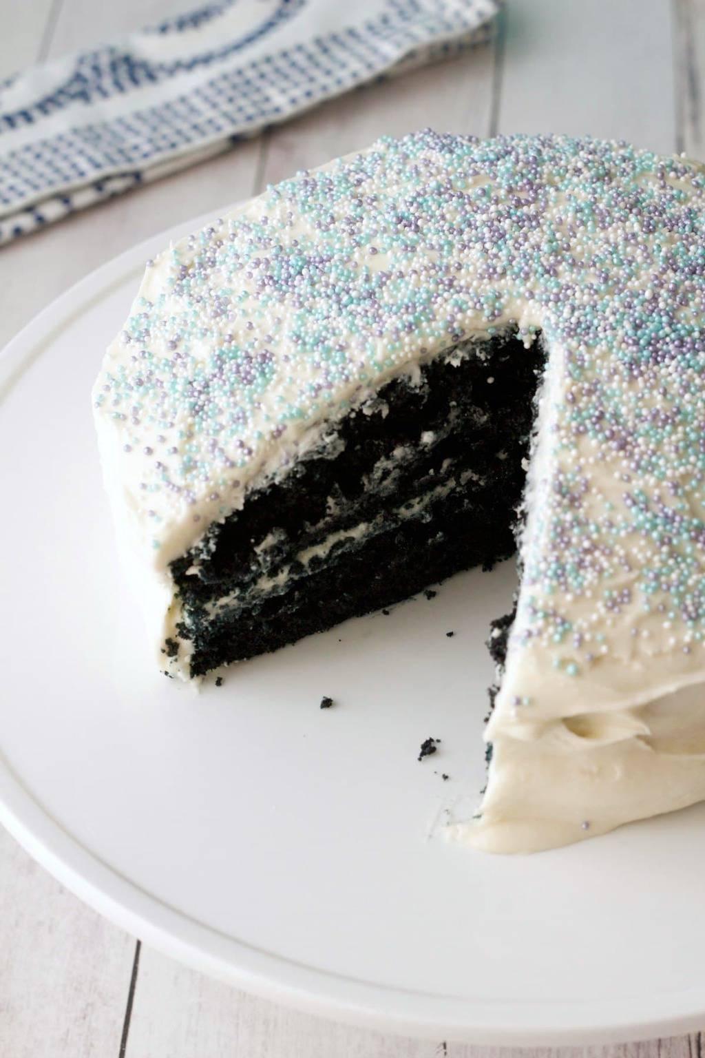 Vegan Blue Velvet Cake. Midnight blue cake frosted with vegan vanilla frosting. Simple, moist and delicious! #vegan #lovingitvegan #dessert #cake #bluevelvet