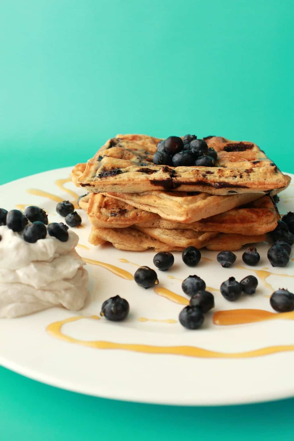 Vegan Blueberry Waffles. Delicious for breakfast with whipped coconut cream, fresh blueberries and maple syrup!
