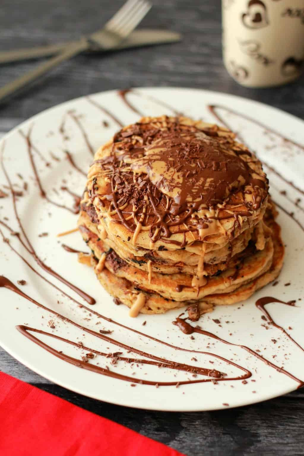 Vegan Chocolate Chip Peanut Butter Pancakes. Fabulous for breakfast, or dessert! #vegan #lovingitvegan #pancakes #dessert #breakfast