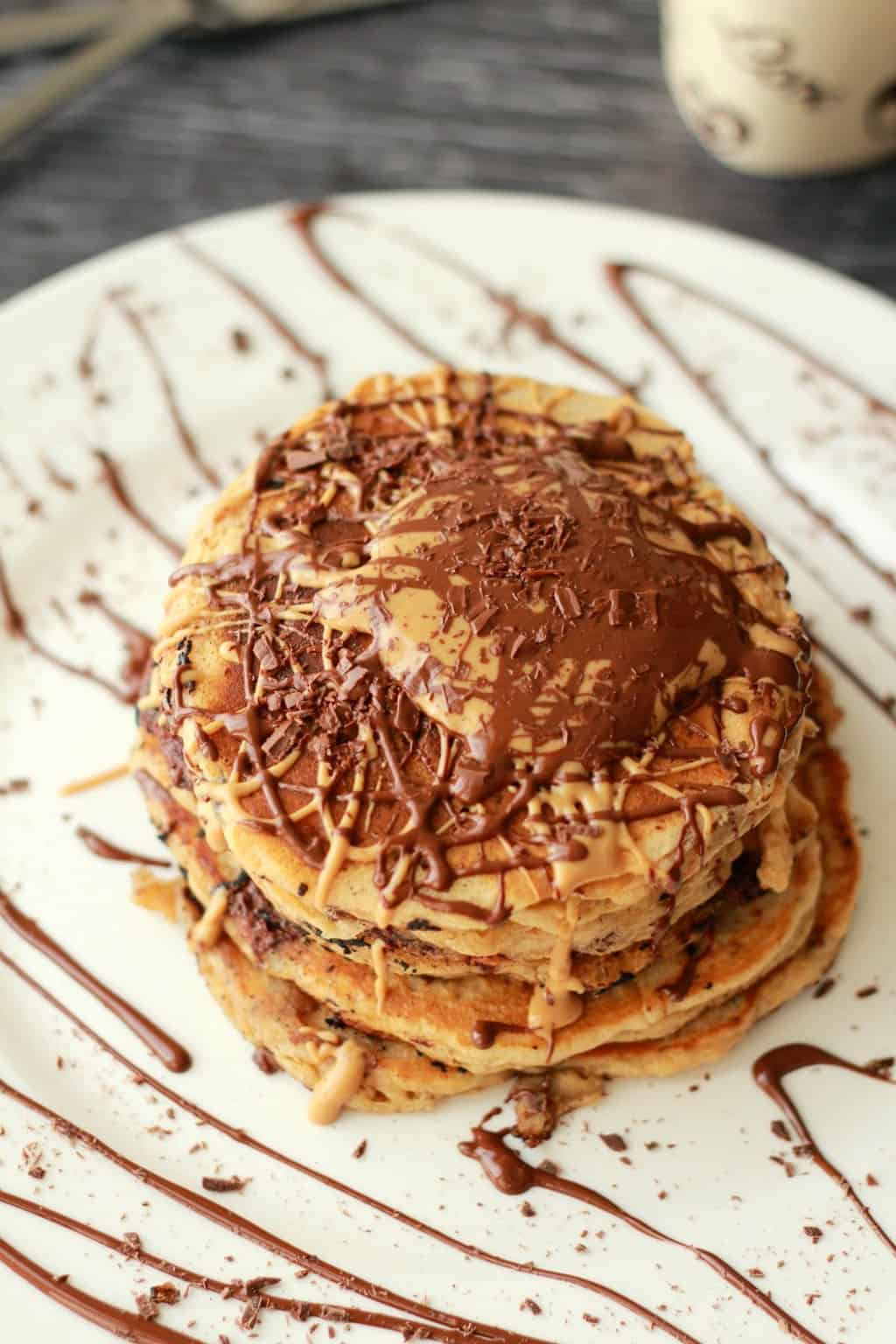 Vegan Chocolate Chip Peanut Butter Pancakes! Soooo good! #vegan #lovingitvegan #dessert #pancakes #breakfast