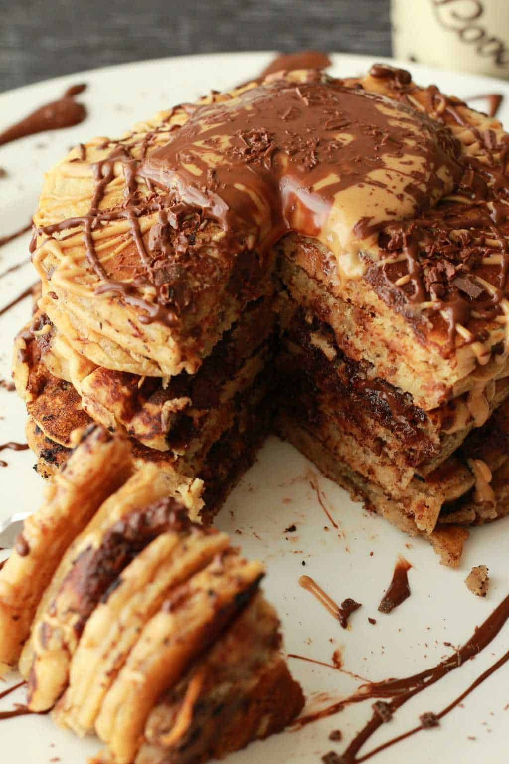 Deliciously fluffy Chocolate Chip Peanut Butter Pancakes! Perfect for a fancy vegan breakfast! Or Dessert! #vegan #lovingitvegan #dessert #pancakes #breakfast