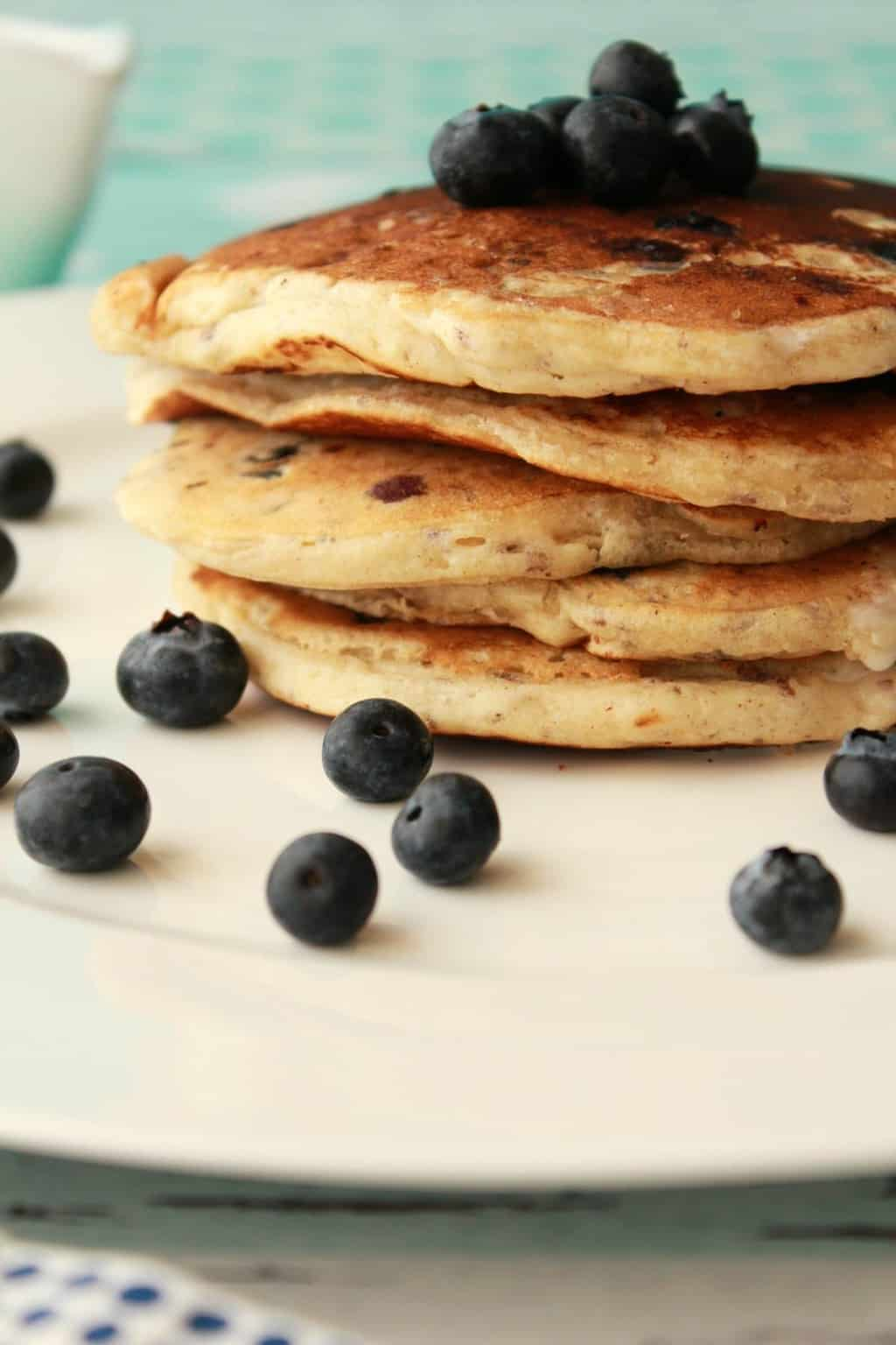 Vegan Blueberry Pancakes. Perfect for a vegan breakfast with fresh blueberries, vegan whipped cream and maple syrup! #vegan #lovingitvegan #breakfast #pancakes