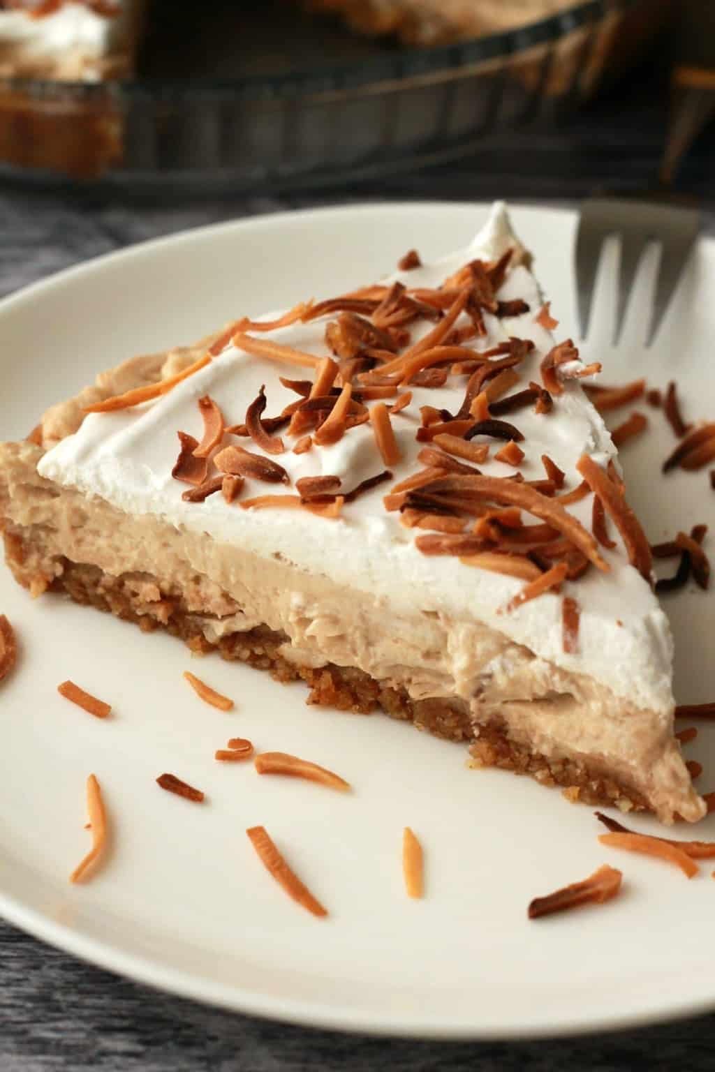 Vegan Coconut Cream Pie. 3-layers of deliciousness topped with toasted coconut flakes! Vegan and gluten-free! #vegan #lovingitvegan #dessert #pie #glutenfree #dairyfree