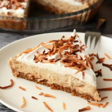 Slice of vegan coconut cream pie on a white plate.