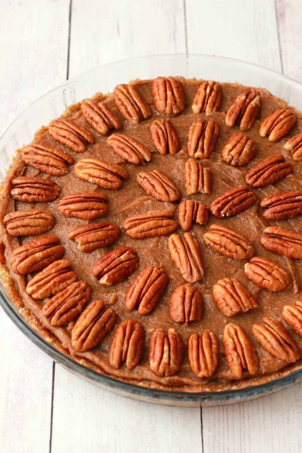 Deliciously raw vegan pecan pie. 3-layers of raw goodness, utterly divine served with vegan whipped cream! #vegan #lovingitvegan #pecanpie #glutenfree #raw #dessert