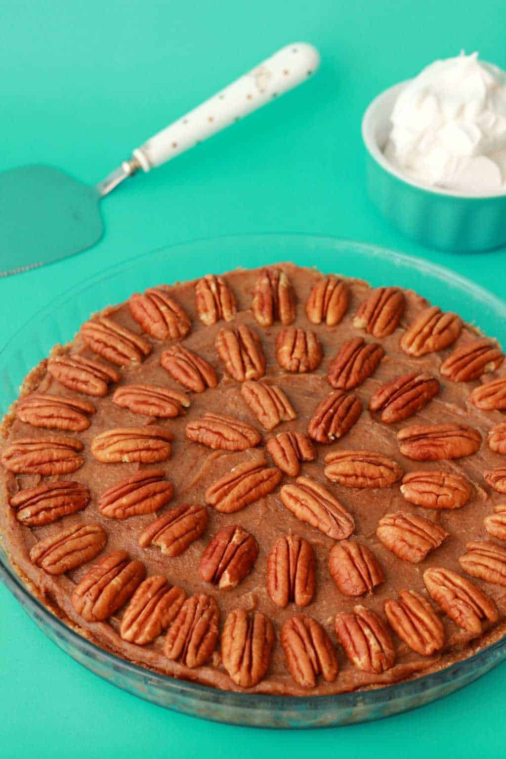 Deliciously raw vegan pecan pie, utterly divine served with vegan whipped cream! Raw and Gluten-Free. #vegan #lovingitvegan #raw #gluten-free #dessert