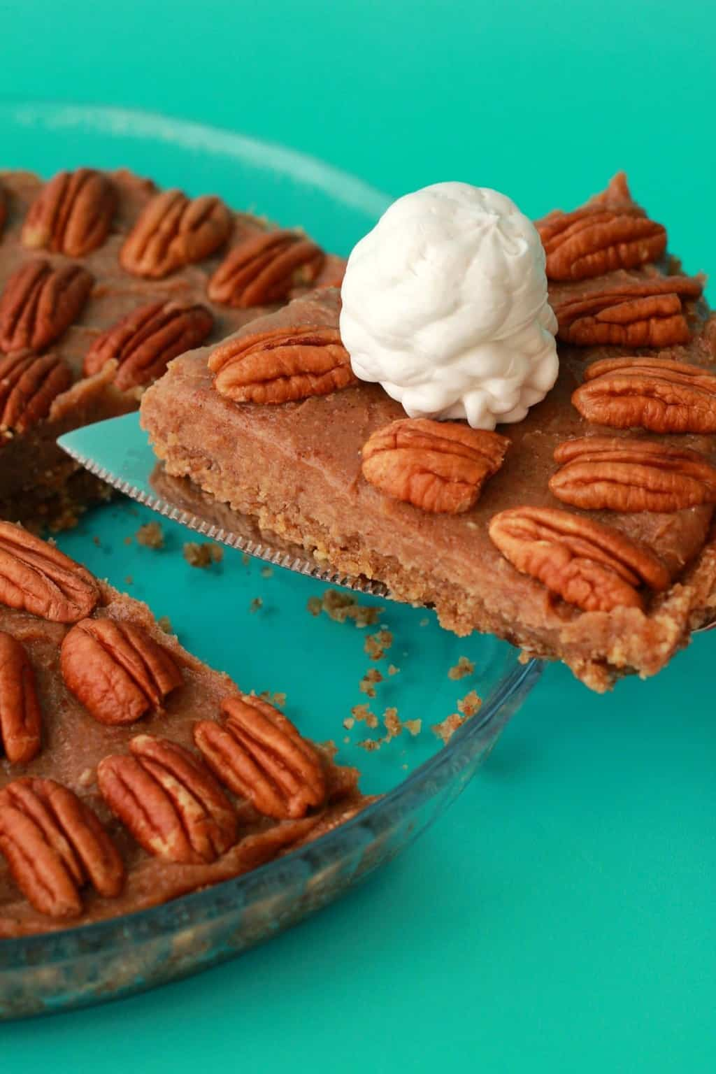 Deliciously raw vegan pecan pie. 3-layers of raw goodness, packed with pecans and pecan flavor, super easy to make, and utterly divine served with vegan whipped cream! #vegan #lovingitvegan #raw #pie #dessert