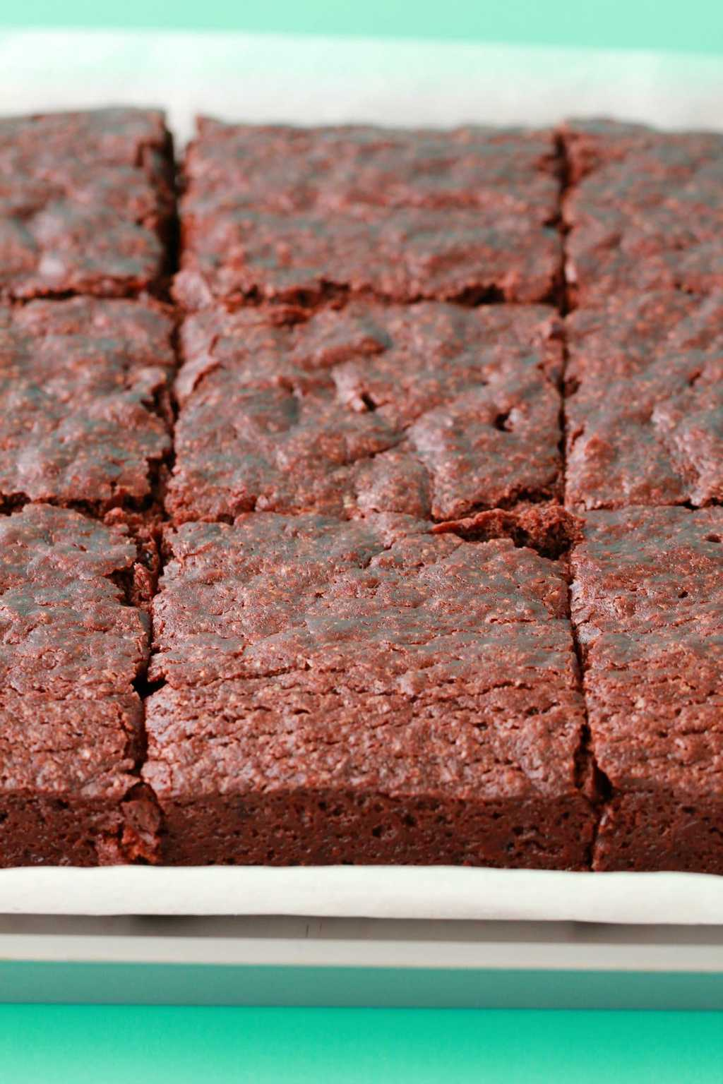 Freshly baked and sliced tray of vegan brownies.